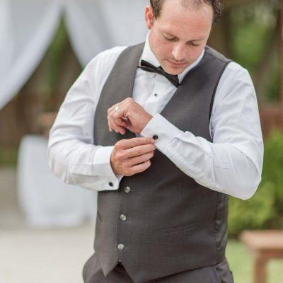 groom getting dressed wedding