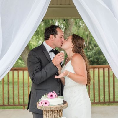 wedding couple sharing cake